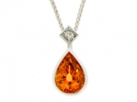 A fine orange garnet and diamond pendant in 18ct white gold.