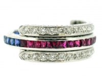 Ruby, sapphire and diamond band ring.
