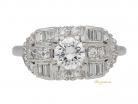 front view Round and baguette diamond cluster ring, American, circa 1950.