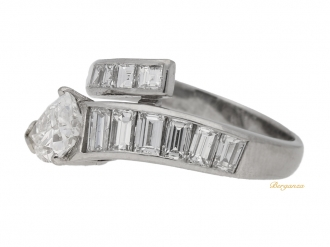 front view Drop, baguette and square cut diamond ring, circa 1960.