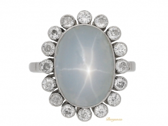 front-Star-sapphire-and-diamond-coronet-cluster-ring,-circa-1920.-berganza-hatton-garden