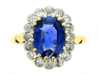Sapphire and diamond cluster ring in platinum and gold, circa 1915.