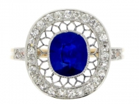 Sapphire and diamond cluster ring in platinum and gold.