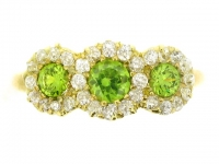 Antique demantoid and diamond triple cluster ring, circa 1895.
