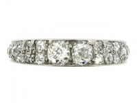 Old cut diamond set eternity ring in platinum, circa 1920.