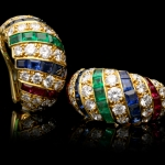 Cartier vintage ruby, sapphire, emerald and diamond earrings, circa 1978.