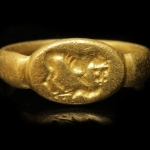 Ancient Greek gold signet ring with lion, circa 5th - 3rd century BC.