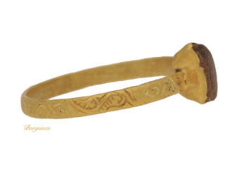 front view Medieval engraved gold amethyst ring, circa 14th 15th century.