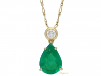 front view Emerald and diamond pendant, French, circa 1970.