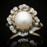 Natural pearl and diamond floral cluster ring, circa 1870.