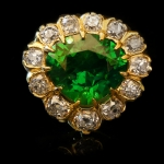 Rare demantoid and diamond coronet cluster ring, circa 1900.