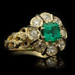 Emerald, diamond and enamel ring, circa 1890.