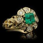 Emerald, diamond and enamel ring, circa 1890.