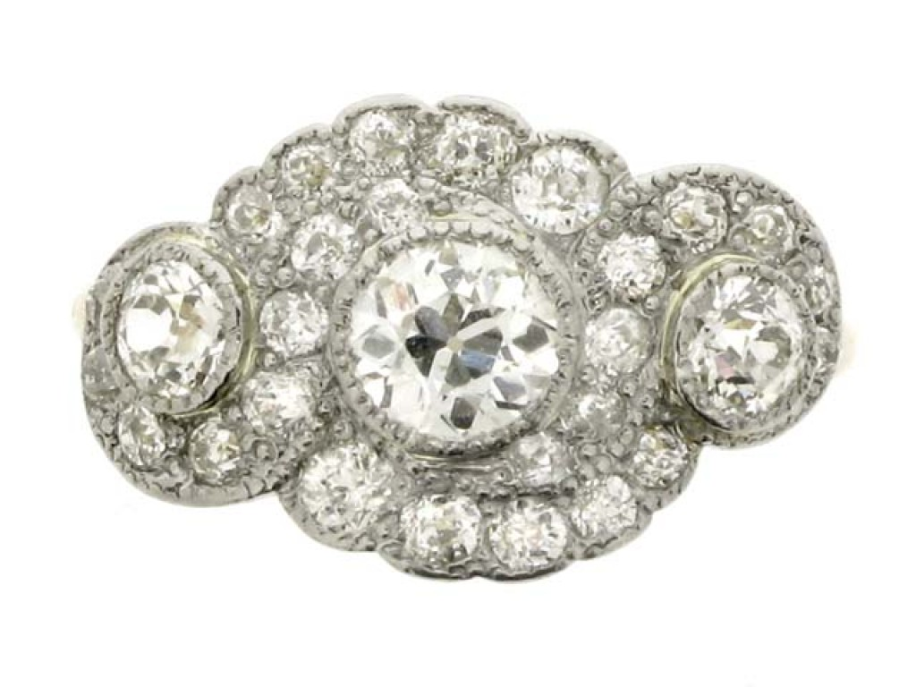 front view Triple diamond cluster ring, circa 1905.