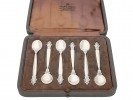 A boxed set of Georg Jensen silver spoons