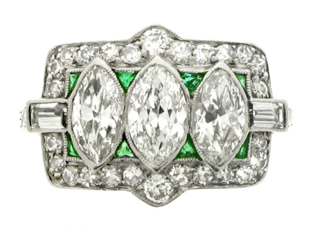 front view Marquise cut diamond and emerald diamond ring, circa 1920.