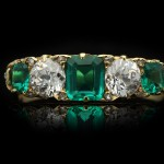 Victorian Colombian emerald and diamond five stone ring, circa 1900.