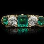 Victorian Colombian emerald and diamond five stone ring, circa 1900.