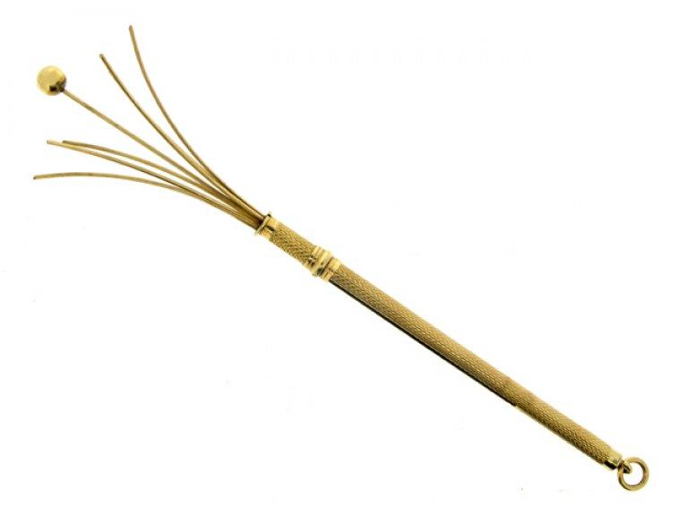 Yellow gold swizzle stick berganza hatton garden