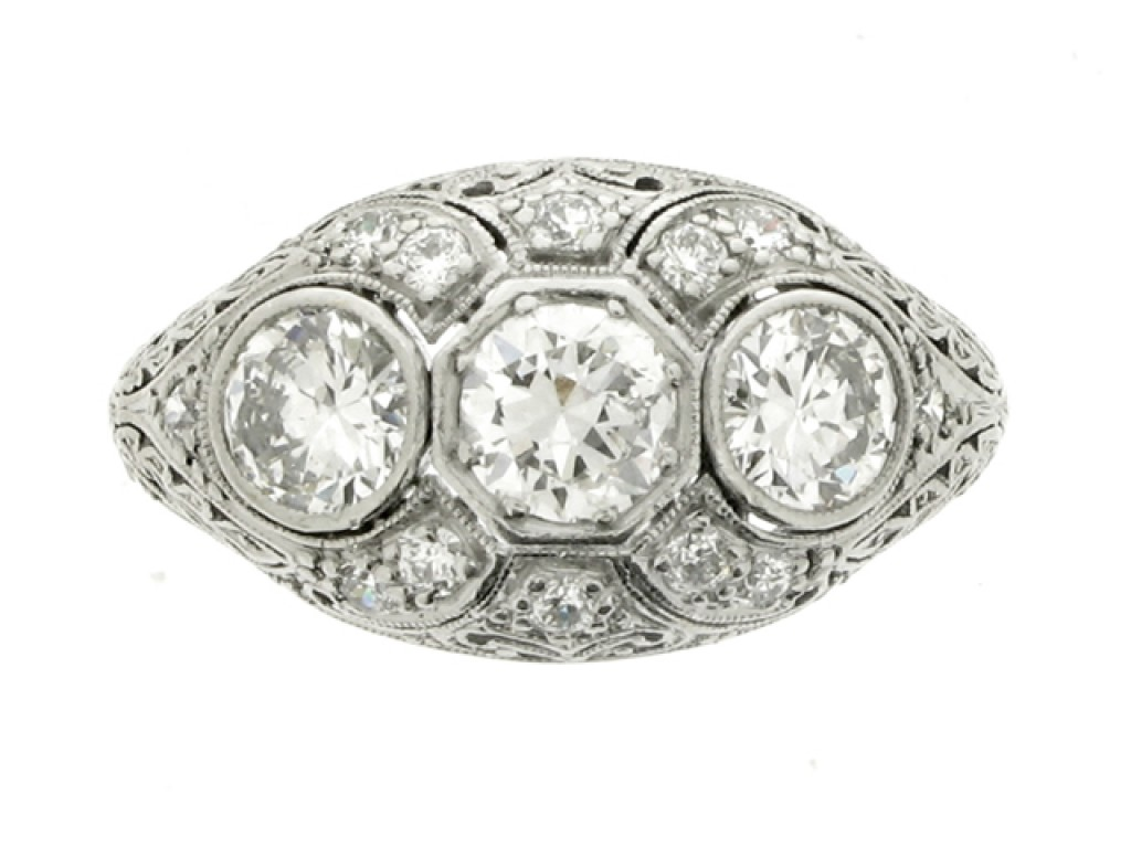front view Ornate three stone diamond cluster ring, circa 1910.
