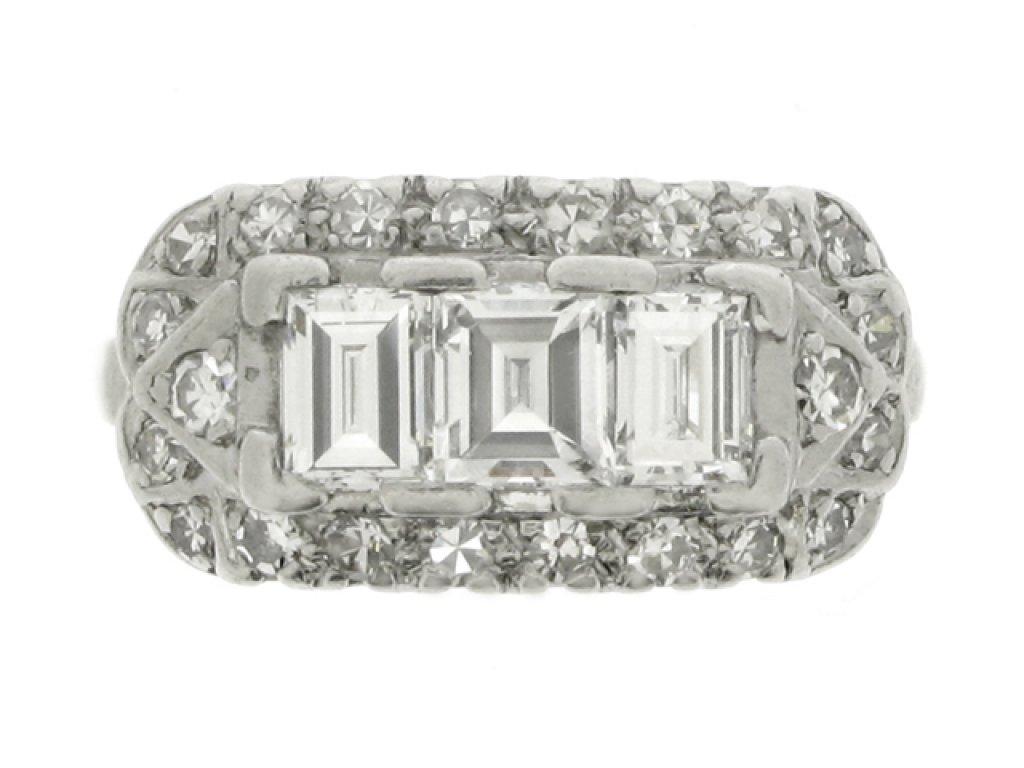 hand view Three stone step cut diamond cluster ring, American, circa 1930.