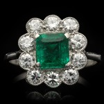 Art Deco emerald and diamond coronet cluster ring, circa 1920.