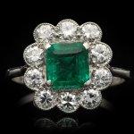 Art Deco emerald and diamond coronet cluster ring, circa 1920.