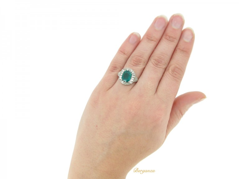 hand view Art Deco emerald and diamond coronet cluster ring, circa 1925.