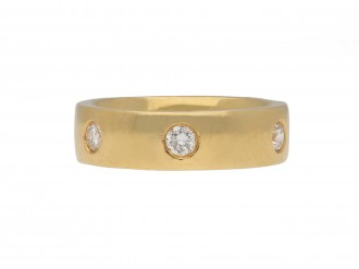 Diamond set band in 18 carat gold band berganza hatton garden