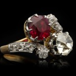 Ruby and diamond cross over ring, circa 1905.