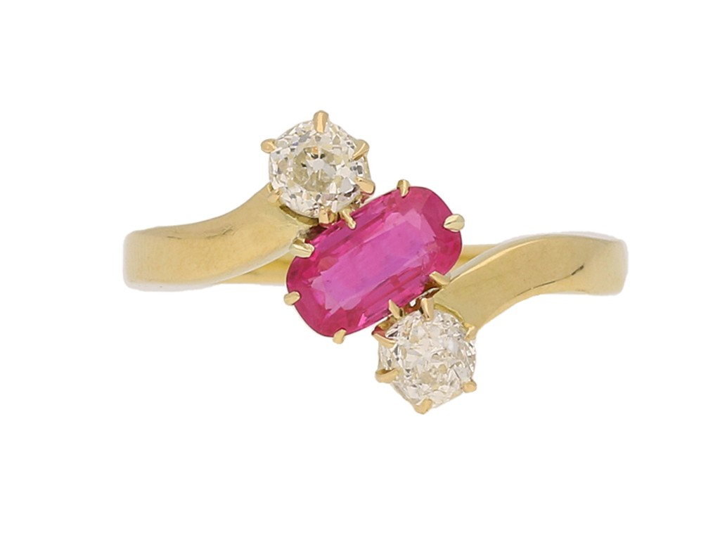front view Pink sapphire and diamond three stone cross over ring