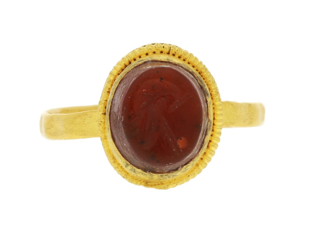 front view Ancient Roman gold ring with helmet intaglio, circa 3rd century AD.