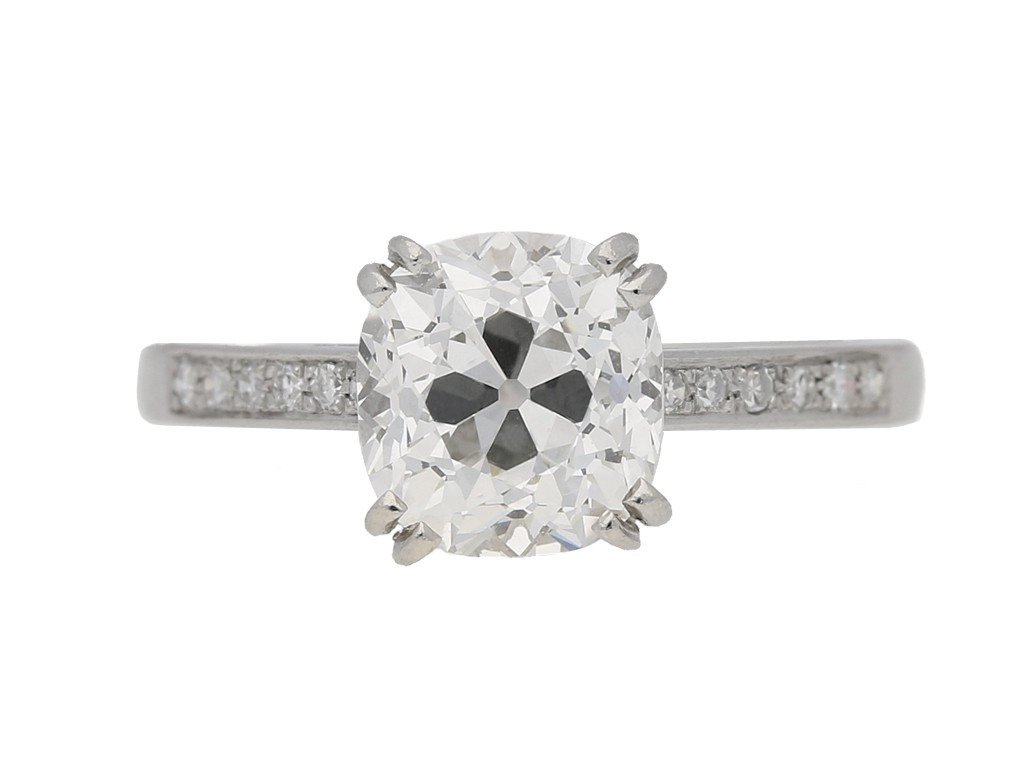 front view Cushion shape old mine flanked solitaire diamond ring, circa 1950. berganza hatton garden