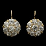 Diamond coronet cluster drop earrings, circa 1890.