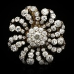 Victorian diamond flower brooch/pendant with chain, circa 1890.