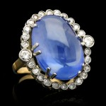 Cabochon Ceylon sapphire and diamond coronet cluster ring, circa 1920.