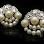 Natural pearl and diamond cluster earrings, circa 1915.