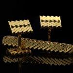 Van Cleef & Arpels gold cufflink and tie pin set, circa 1970.