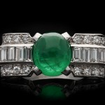 Art Deco cabochon emerald and diamond ring, circa 1925.