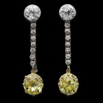 Old mine fancy yellow diamond drop earrings, circa 1910.