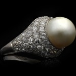 Antique natural pearl and diamond cluster ring, circa 1920.