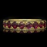 Vintage ruby half eternity band, circa 1960.