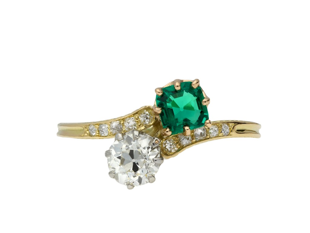 Colombian emerald and diamond crossover ring hatton garden