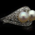 J.E. Caldwell antique natural pearl and diamond two stone ring, American, circa 1910.