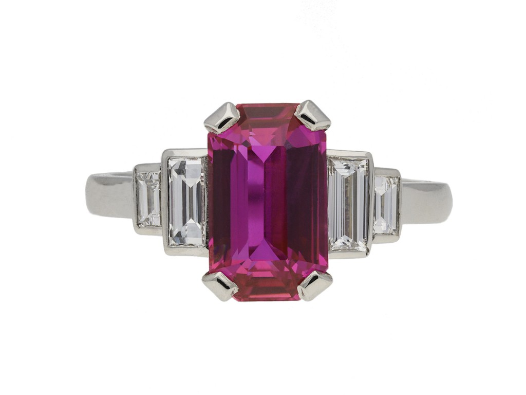 Ruby and diamond flanked solitaire ring berganza hatton garden