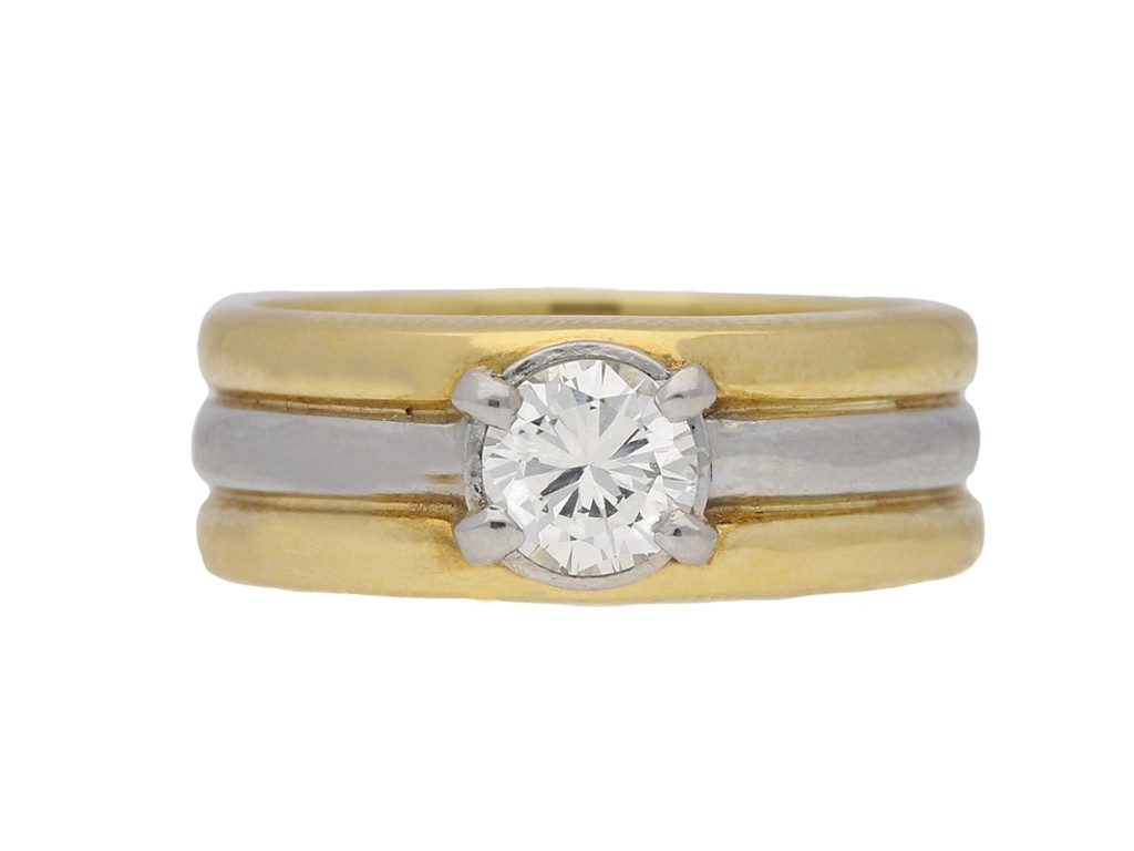 Contemporary solitaire diamond ring in 18ct yellow gold.