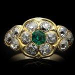 Antique emerald and diamond cluster ring, circa 1870.
