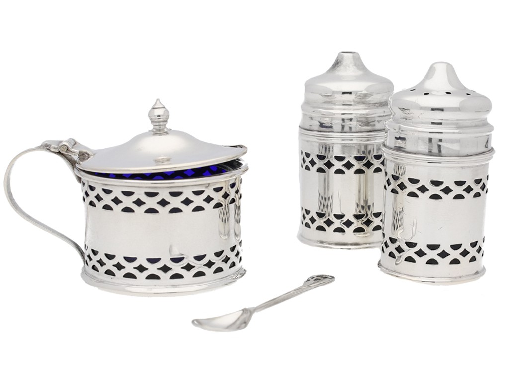 A silver condiment set in silver assayed in Birmingham 1913.