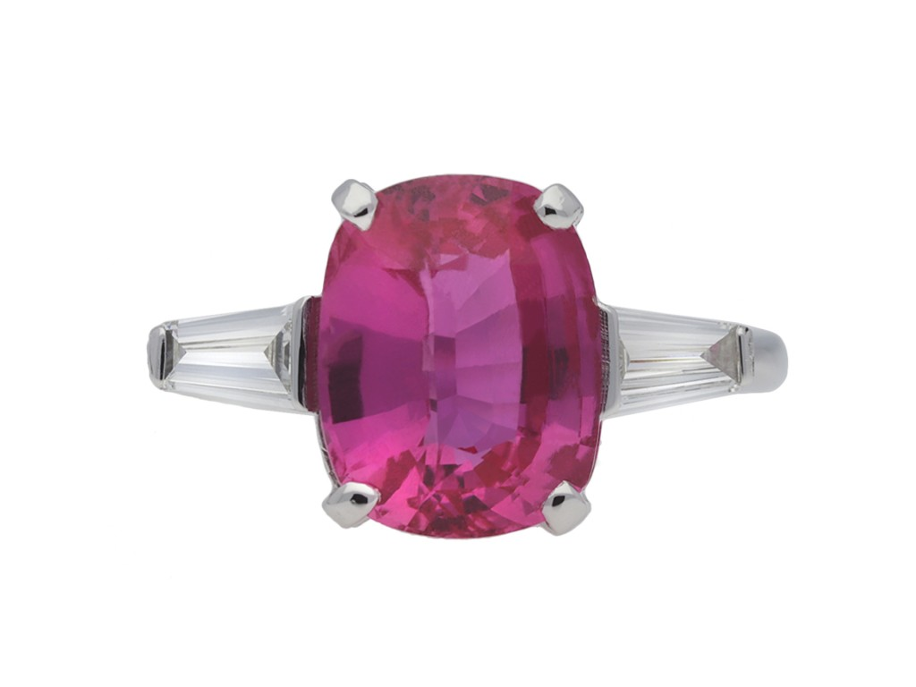 Pink sapphire and diamond flanked solitaire ring