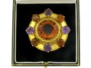 boxed view Antique brooch set with citrines and amethysts